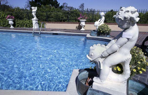 PHOTO: Cast stone figural fountain with four-part copper jardinieres belonging to the late Hungarian-American actress Zsa Zsa Gabor around the pool at the actress' residence in Bel Air, Calif., April 12, 2018. (Mike Nelson/EPA via Shutterstock)