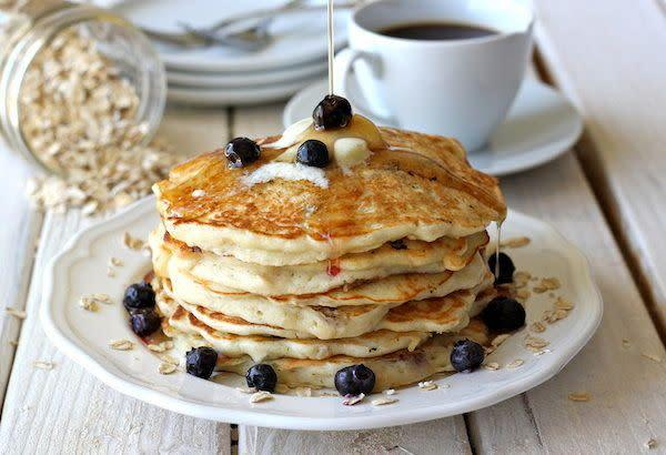 "<strong>Get the <a href=""http://damndelicious.net/2012/10/18/blueberry-oatmeal-yogurt-pancakes/"" rel=""nofollow noopener"" target=""_blank"" data-ylk=""slk:Blueberry Oatmeal Yogurt Pancakes recipe"" class=""link rapid-noclick-resp"">Blueberry Oatmeal Yogurt Pancakes recipe</a> from Damn Delicious</strong>"