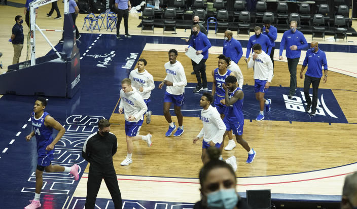 Seton Hall players and staff head off the court for the national anthem before an NCAA college basketball game against Connecticut, Saturday, Feb. 6, 2021, at Harry A. Gampel Pavilion in Storrs, Conn. (David Butler II/Pool Photo via AP)