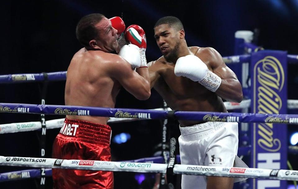 Anthony Joshua, right, is back in the ring this weekend (Andrew Couldridge/PA) (PA Archive)