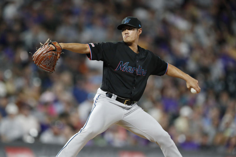 Miami Marlins relief pitcher Wei-Yin Chen works against the Colorado Rockies during the seventh inning of a baseball game Saturday, Aug. 17, 2019, in Denver. (AP Photo/David Zalubowski)