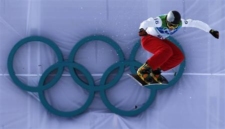 Andorra's Marin Tarroch competes during the men's snowboard cross qualifying at the Vancouver 2010 Winter Olympics