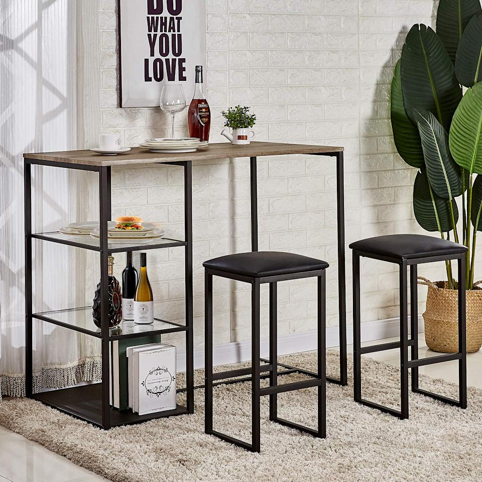 """<h3><a href=""""https://www.amazon.com/dp/B07H19MD6K/ref=as_li_ss_tl?"""" rel=""""nofollow noopener"""" target=""""_blank"""" data-ylk=""""slk:Vecelo 3-Piece Pub Dining Set"""" class=""""link rapid-noclick-resp"""">Vecelo 3-Piece Pub Dining Set</a></h3><br>Fitting an entire dining table (and chairs) inside a small space is like squeezing a giraffe into a — you get the picture. Try creating a more space-savvy dinner area with this three-piece set that boasts an elevated and streamlined design.<br><br><strong>VECELO</strong> 3-Piece Pub Dining Set Table with Cushion Stools, $, available at <a href=""""https://amzn.to/33nYE7M"""" rel=""""nofollow noopener"""" target=""""_blank"""" data-ylk=""""slk:Amazon"""" class=""""link rapid-noclick-resp"""">Amazon</a>"""