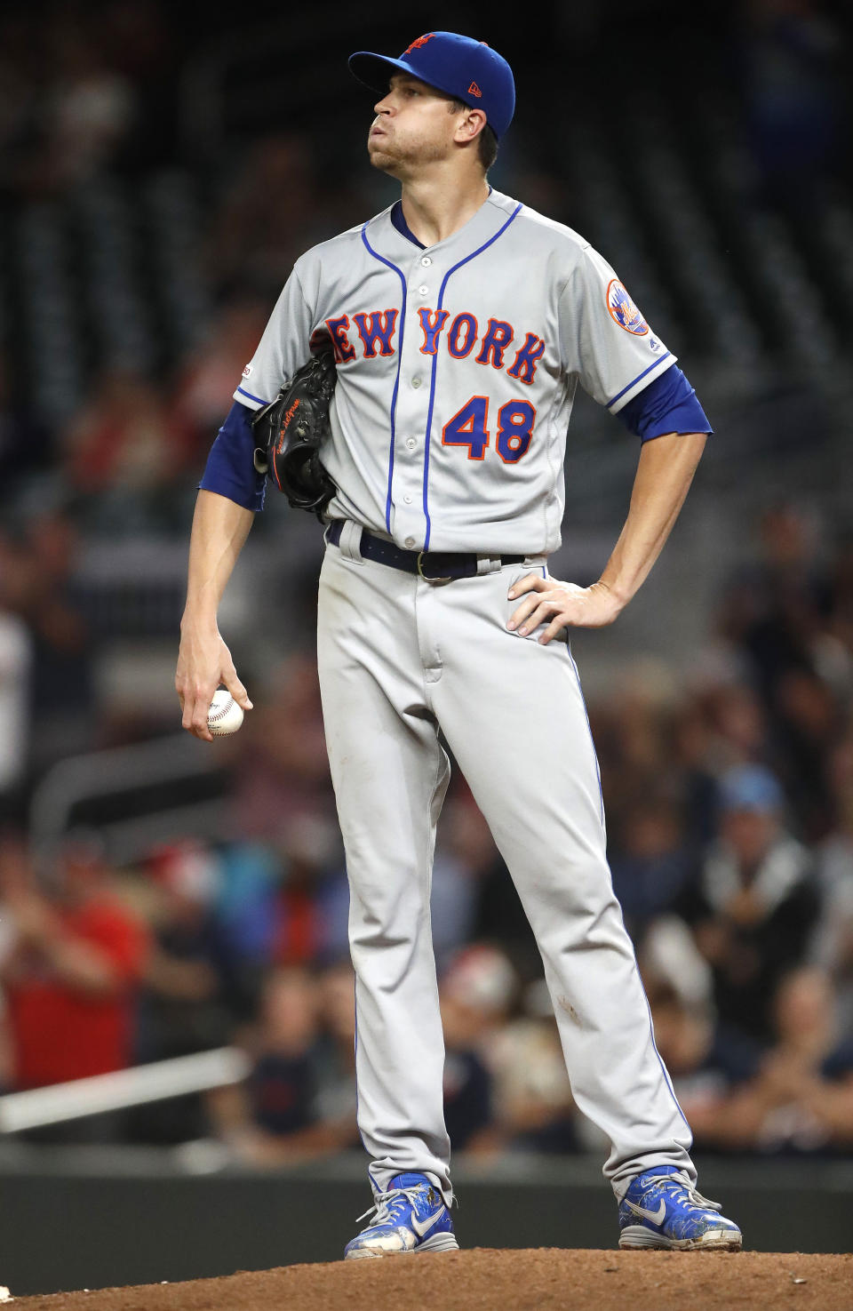 New York Mets starting pitcher Jacob deGrom (48) looks up at the scoreboard after losing his bid for a shutout on a home run by Atlanta Braves' Freddie Freeman in the ninth inning of a baseball game Tuesday, June 18, 2019, in Atlanta. New York won 10-2. (AP Photo/John Bazemore)