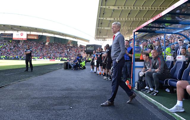 "Soccer Football - Premier League - Huddersfield Town vs Arsenal - John Smith's Stadium, Huddersfield, Britain - May 13, 2018 Arsenal manager Arsene Wenger looks on REUTERS/Peter Powell EDITORIAL USE ONLY. No use with unauthorized audio, video, data, fixture lists, club/league logos or ""live"" services. Online in-match use limited to 75 images, no video emulation. No use in betting, games or single club/league/player publications. Please contact your account representative for further details."