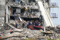 Crews work in the rubble of Champlain Towers South residential condo, Tuesday, June 29, 2021, in Surfside, Fla. Many people were still unaccounted for after Thursday's fatal collapse. (AP Photo/Lynne Sladky)