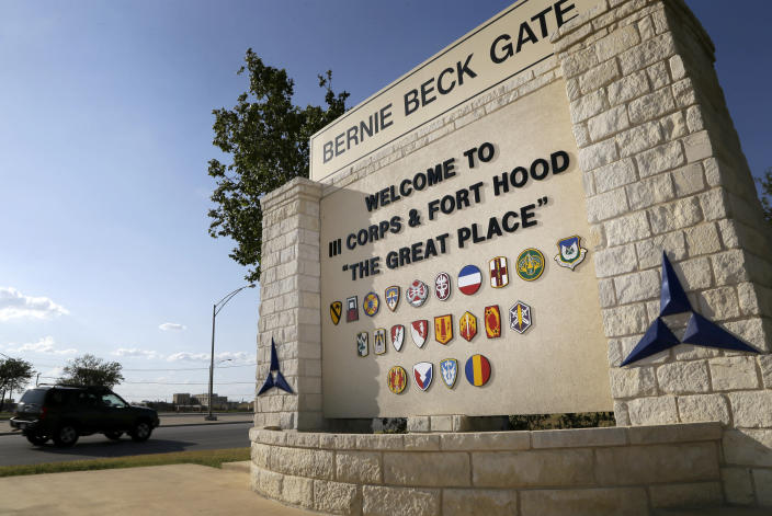 FILE - In this July 9, 2013, file photo, traffic flows through the main gate past a welcome sign in Fort Hood, Texas. U.S. officials say the Army plans to put a civilian in charge of the command that conducts criminal investigations, in response to widespread criticism that the unit is understaffed, overwhelmed and filled with inexperienced investigators.(AP Photo/Tony Gutierrez, File)