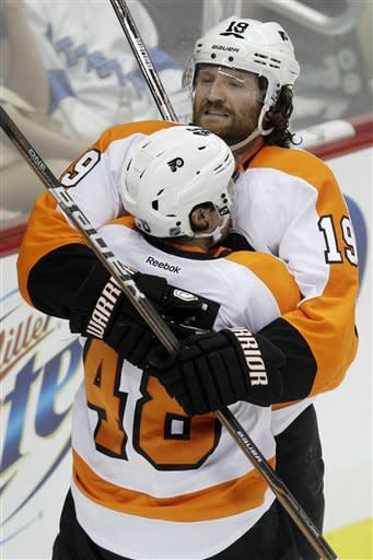 Philadelphia Flyers' Scott Hartnell (19) celebrates his first-period goal with Danny Briere (48) against the Pittsburgh Penguins during Game 5 of an opening-round NHL Stanley Cup hockey playoff series in Pittsburgh Friday, April 20, 2012. (AP Photo/Gene J. Puskar)