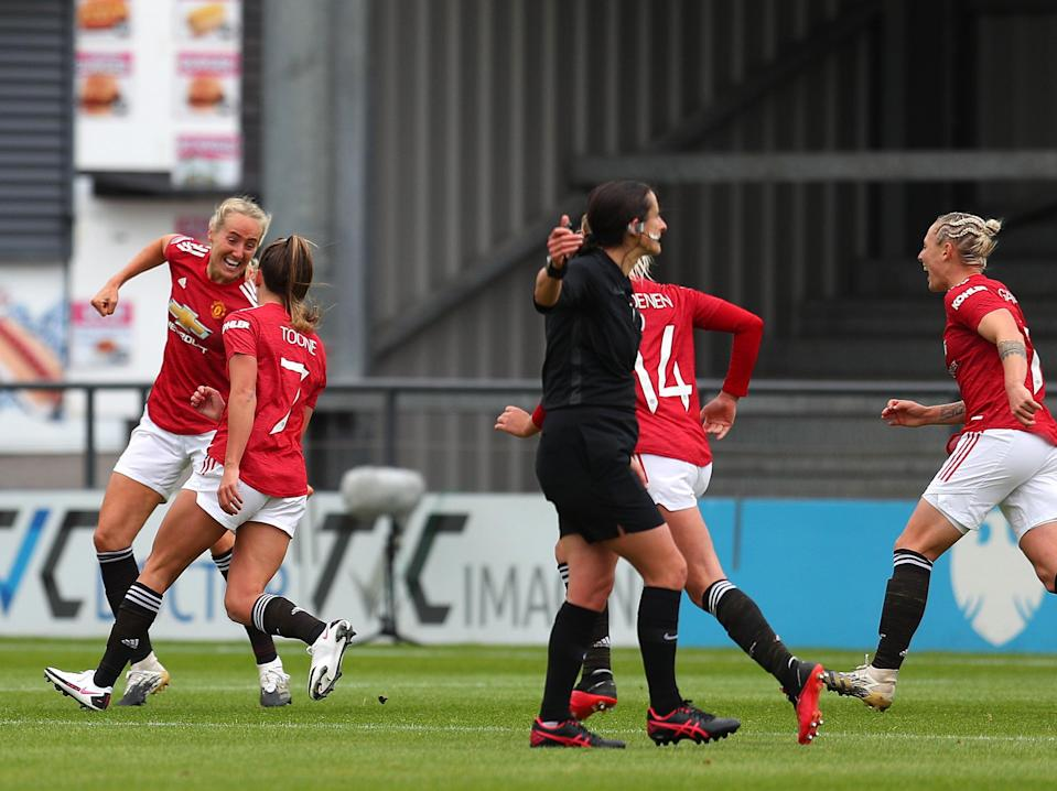 Manchester United Women players celebrate Millie Turner's match-winning goal (Getty Images)
