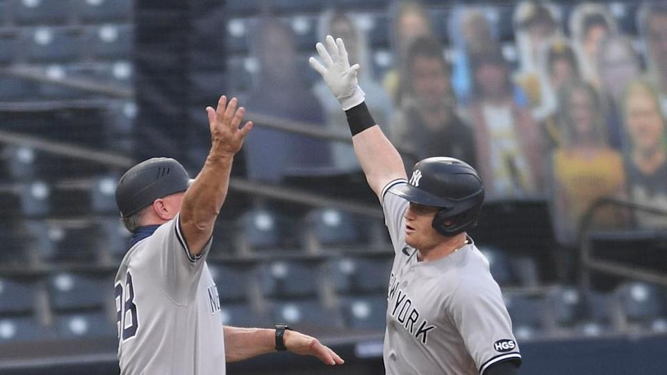 Clint Frazier celebrates homer with third base coach Phil Nevin