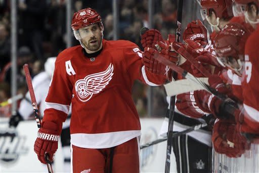 Detroit Red Wings center Henrik Zetterberg (40), of Sweden, high-fives his teammates after scoring during the first period of an NHL hockey game against the Los Angeles Kings in Detroit, Friday, March 9, 2012. (AP Photo/Carlos Osorio)