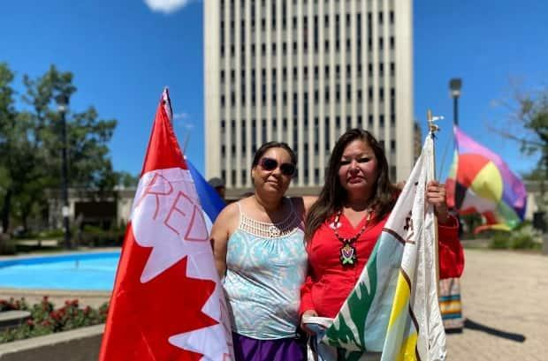 Kerry Bellegarde-Opoonechaw and Star Andreas held a small protest outside of city hall last summer calling for the removal of the John A. Macdonald statue from Victoria Park.