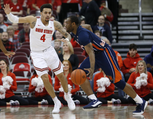 Morgan State's LaPri McCray-Pace, right, tries to drive the lane against Ohio State's Duane Washington during the second half of an NCAA college basketball game Friday, Nov. 29, 2019, in Columbus, Ohio. Ohio State beat Morgan State 90-57. (AP Photo/Jay LaPrete)