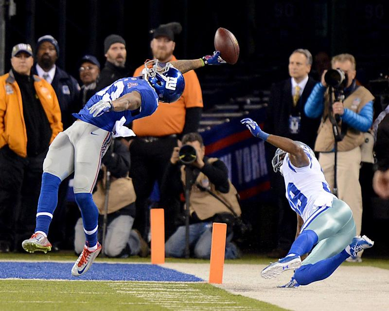 New York Giants wide receiver Odell Beckham makes stunning touchdown catch in the first half during game against the Dallas Cowboys. Sunday, November 23, 2014 at the MetLife Stadium in East Rutherford, New Jersey. (Photo by Robert Sabo/NY Daily News via Getty Images)