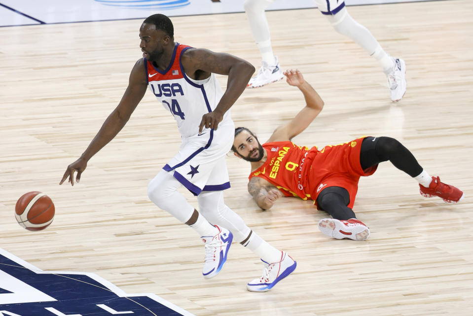 Draymond Green steals the ball from Ricky Rubio during an exhibition game ahead of the Tokyo Olympics