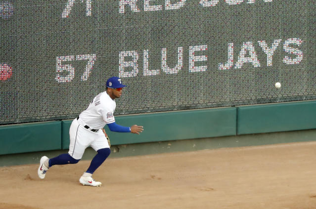 Texas Rangers right fielder Willie Calhoun chases down a double by Tampa Bay Rays' Tommy Pham in the first inning of a baseball game in Arlington, Texas, Wednesday, Sept. 11, 2019. (AP Photo/Tony Gutierrez)