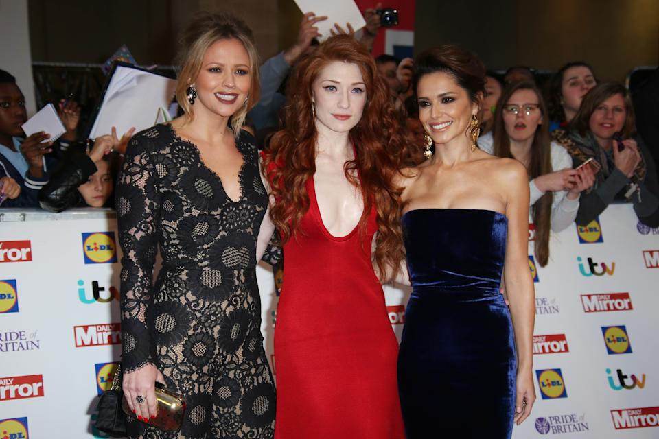 Kimberley Walsh, Nicola Roberts and Cheryl Fernandez-Versini pose for photographers upon arrival at the Pride of Britain Awards 2015 in London, Monday, Sept. 28, 2015. (Photo by Joel Ryan/Invision/AP)