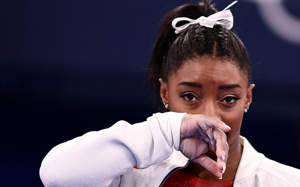 Simone Biles has pulled out of a second event - AFP