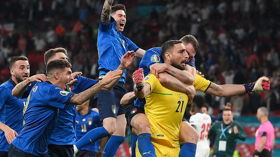 Pictured here, Italy celebrate after their penalty shootout victory against England.