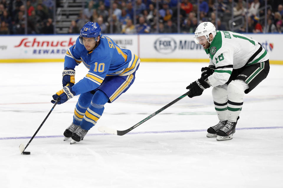 St. Louis Blues' Brayden Schenn (10) brings the puck down the ice as Dallas Stars' Jason Dickinson defends during the second period of an NHL hockey game Saturday, Feb. 8, 2020, in St. Louis. (AP Photo/Jeff Roberson)