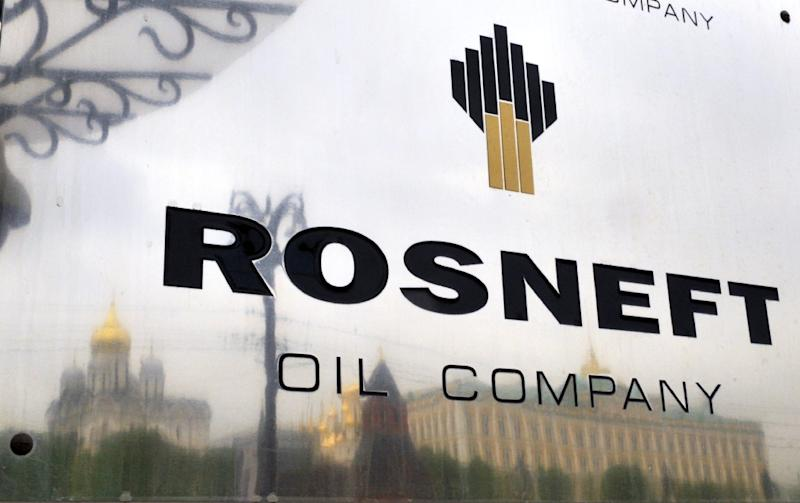 Russia's state-controlled energy giant Rosneft said Wednesday its annual net profit for 2014 was down by nearly 10 percent after Russia's economy took a battering from plunging oil prices and Western sanctions over Ukraine