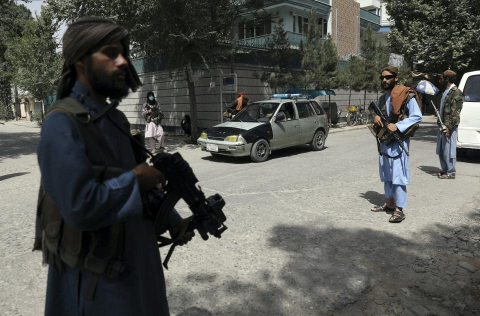 """<span class=""""caption"""">Taliban fighters stand guard at a checkpoint in Kabul, Afghanistan, on Aug. 18, 2021.</span> <span class=""""attribution""""><span class=""""source"""">(AP Photo/Rahmat Gul) </span></span>"""