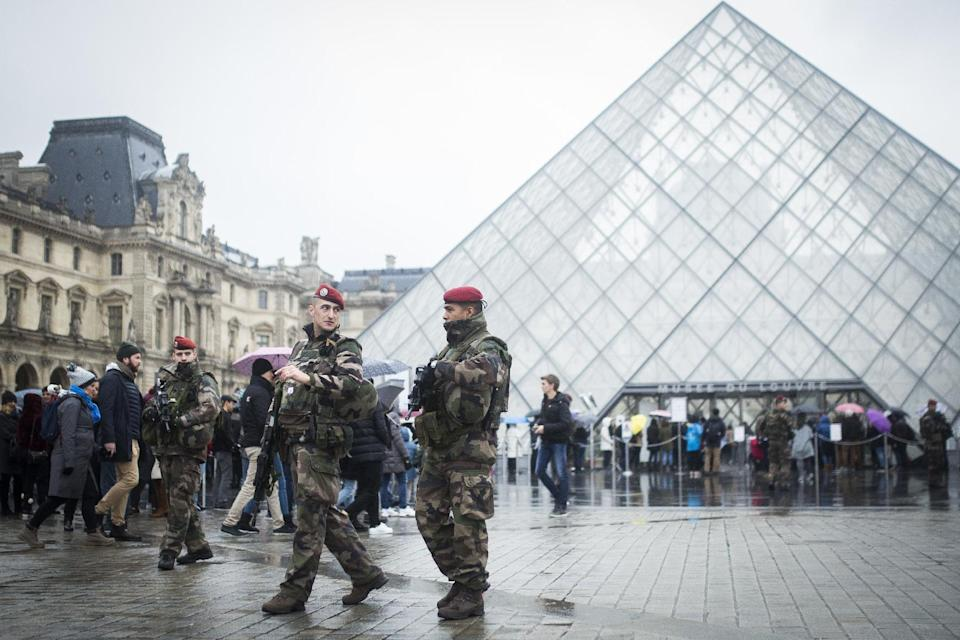 """French soldiers patrol in the courtyard of the Louvre museum in Paris, Saturday, Feb. 4, 2017. The Louvre in Paris reopened to the public Saturday morning, less than 24-hours after a machete-wielding assailant shouting """"Allahu Akbar!"""" was shot by soldiers, in what officials described as a suspected terror attack. (AP Photo/Kamil Zihnioglu)"""