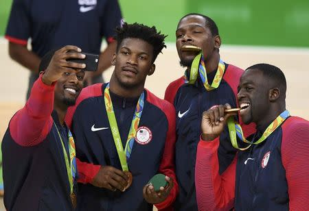Harrison Barnes takes a selfie with Jimmy Butler, Kevin Durant and Draymond Green of the U.S. after the basketball victory ceremony REUTERS/Dylan Martinez