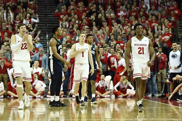 MADISON, WISCONSIN - MARCH 02: Ethan Happ #22 and Khalil Iverson #21 of the Wisconsin Badgers react to a turnover by the Penn State Nittany Lions during a game at Kohl Center on March 02, 2019 in Madison, Wisconsin. (Photo by Stacy Revere/Getty Images)