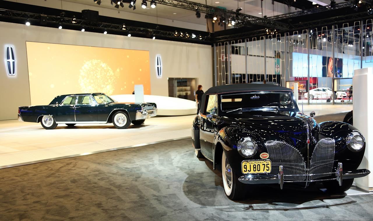 1940 Lincoln Continental Cabriolet, right, and the 1961 Lincoln Continental Sedan are seen as part of Lincoln's Heritage on Display at the Los Angeles Auto Show press day, Wednesday, Nov. 28, 2012 in Los Angeles. (Photo by Matt Sayles/Invision for Lincoln/AP Images)