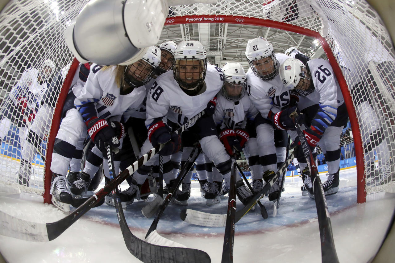 <p>Players from the United States gather in front of the goal before the preliminary round of the women's hockey game Finland at the 2018 Winter Olympics in Gangneung, South Korea, Sunday, Feb. 11, 2018. (Ronald Martinez/Pool Photo via AP) </p>