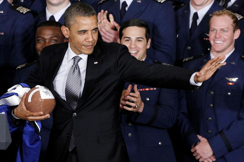 FILE - In this Monday, April 23, 2012 file photo, President Barack Obama strikes the Heisman pose after he awarded the Commander-in-Chief Trophy to the Air Force Academy football team in the East Room of the White House in Washington. How unthinkable it was, not so long ago, that a presidential election would pit a candidate fathered by an African against another condemned as un-Christian. And yet, here it is: Barack Obama vs. Mitt Romney, an African-American and a white Mormon, representatives of two groups and that have endured oppression to carve out a place in the United States. How much progress has America made against bigotry? (AP Photo/Charles Dharapak)