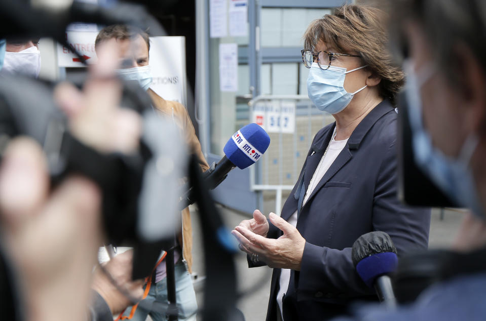 Current socialist Lille mayor and candidate in the second round of the municipal elections, Martine Aubry speaks with journalists before casting her vote, Sunday, June 28, 2020, in Lille, northern France. France is holding the second round of municipal elections in 5,000 towns and cities Sunday that were postponed due to the country's coronavirus outbreak.(AP Photo/Michel Spingler)