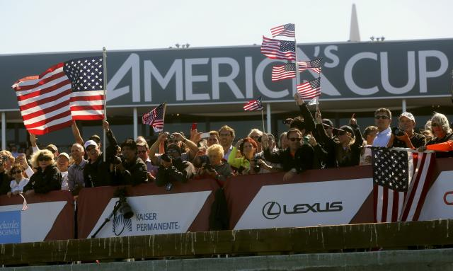 Fans of Oracle Team USA cheer after their team defeated Emirates Team New Zealand during Race 18 of the 34th America's Cup yacht sailing race in San Francisco, California September 24, 2013. REUTERS/Robert Galbraith (UNITED STATES - Tags: SPORT YACHTING)