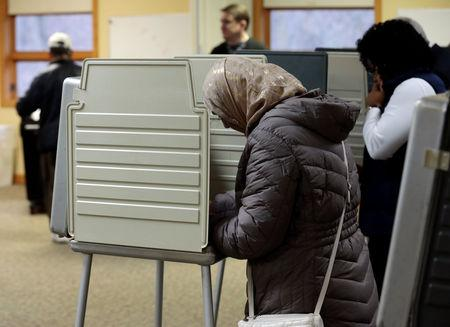People vote in the midterm election  at the St. Paul Lutheran Church in East Lansing, Michigan, U.S. November 6, 2018. REUTERS/Jeff Kowalsky