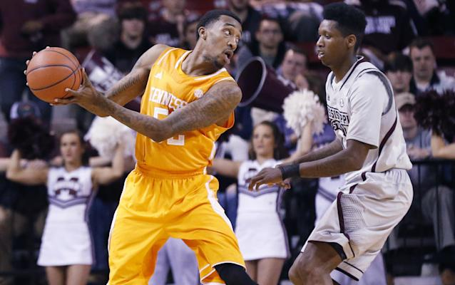 Tennessee guard Jordan McRae (52) tries to pass around the defense of Mississippi State guard Fred Thomas (1) in the first half of an NCAA college basketball game in Starkville, Miss., Wednesday, Feb. 26, 2014. (AP Photo/Rogelio V. Solis)