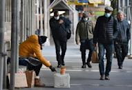 Americans, including this panhandler in New York, are suffering from an economic downturn brought on by the deadly coronavirus pandemic