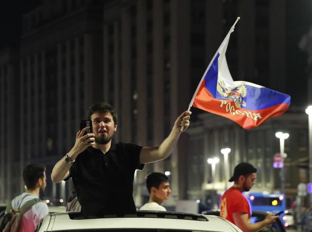 Soccer Football - World Cup - Group A - Russia vs Egypt - Moscow, Russia June 20, 2018 A man waves a Russian flag as he celebrates victory after the match. REUTERS/Maxim Shemetov
