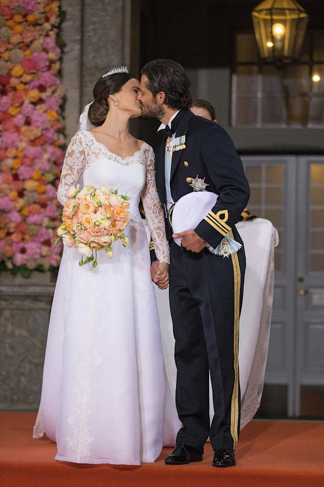 Prince Carl Philip, second in line for the throne, kissed Sofia Hellqvist on the chapel steps after their wedding at The Royal Palace on June 13, 2015.