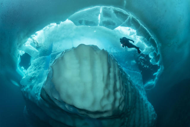 <p>These incredible shots show a stunning iceberg formation beneath the surface of the ocean. (Photo: Franco Banfi/Caters News) </p>