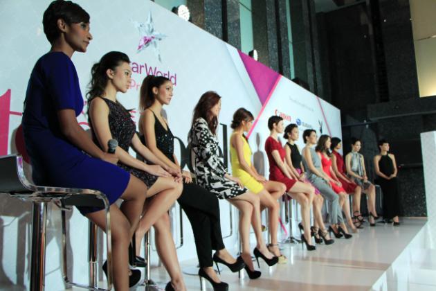 The 14 contestants took their seats at the press conference. (Yahoo! photo/ Deborah Choo)