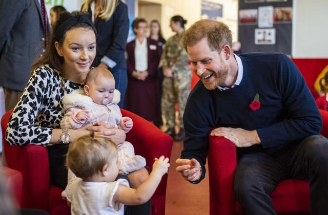 The Duchess was chatting to other mums about how baby Archie was developing [Photos: PA]