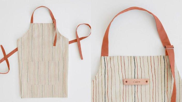 This cute apron has a small leather name tag on the front.