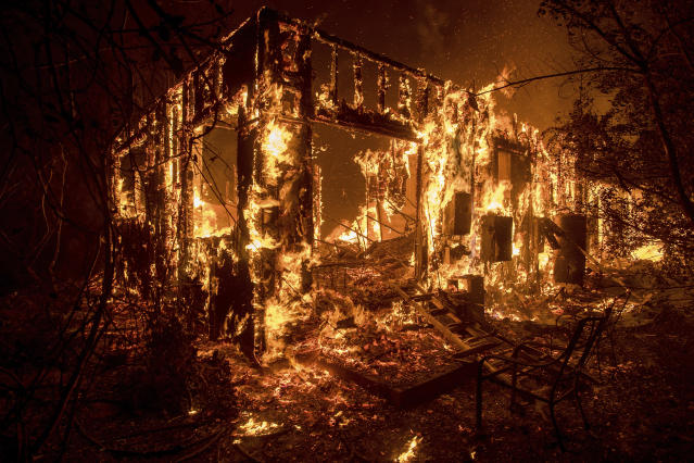 <p>Flames consume a home as a wildfire burns in Ojai, Calif., on Thursday, Dec. 7, 2017. (Photo: Noah Berger/AP) </p>