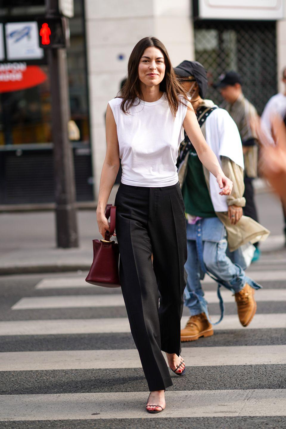 """<p>Monochrome is also a fail-safe office look. Add some summer vibes by switching out your blouse for a sleeveless number, <a href=""""https://www.cosmopolitan.com/uk/fashion/style/g32402890/platform-sandals/"""" rel=""""nofollow noopener"""" target=""""_blank"""" data-ylk=""""slk:sandals"""" class=""""link rapid-noclick-resp"""">sandals</a> and a contrasting bag. </p>"""