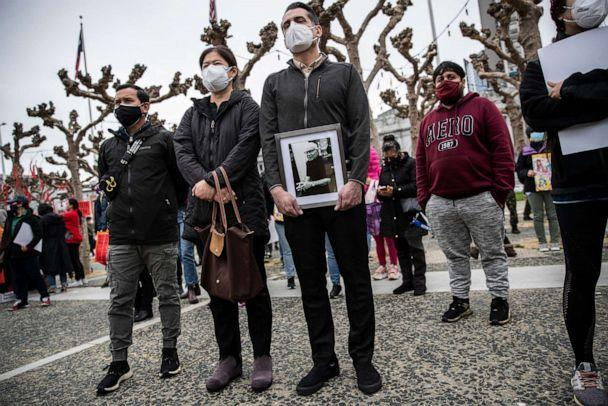 PHOTO: Sanan Wannachit, Monthanus Ratanapakdee, and husband Eric Lawson, who holds a photograph of his late father-in-law Vicha Ratanapakdee, attend a 'Love our People: Heal our Communities' rally in San Francisco, Feb. 14, 2021. (Stephen Lam/The San Francisco Chronicle via Getty Images)