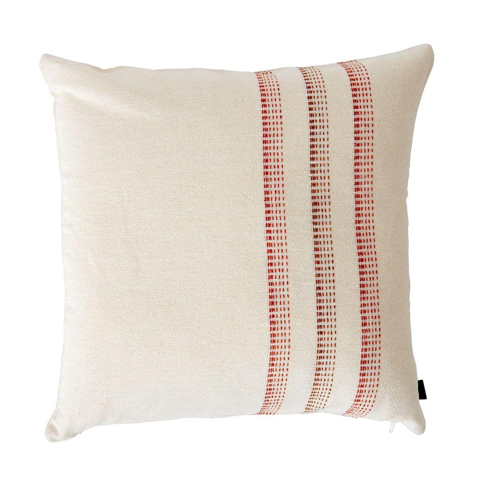 """<p>Made of a blend of linen and cotton with a touch of wool, this cushion is soft to the touch with a simple, country-style design that feels classic yet contemporary. For a coherent look there is a matching throw with the same graduated three stripe pattern. £86, <a href=""""https://www.neptune.com/living-room/scatter-cushions/elland-cushion/"""" rel=""""nofollow noopener"""" target=""""_blank"""" data-ylk=""""slk:neptune.com"""" class=""""link rapid-noclick-resp"""">neptune.com</a></p>"""