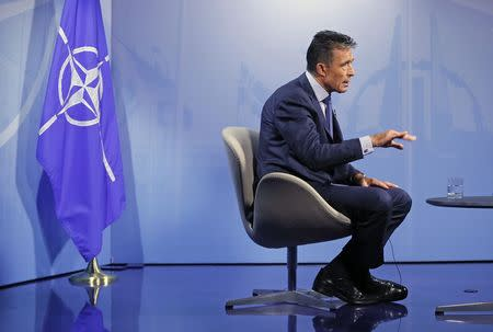 NATO Secretary General Rasmussen speaks during an interview with Reuters at the Alliance headquarters in Brussels