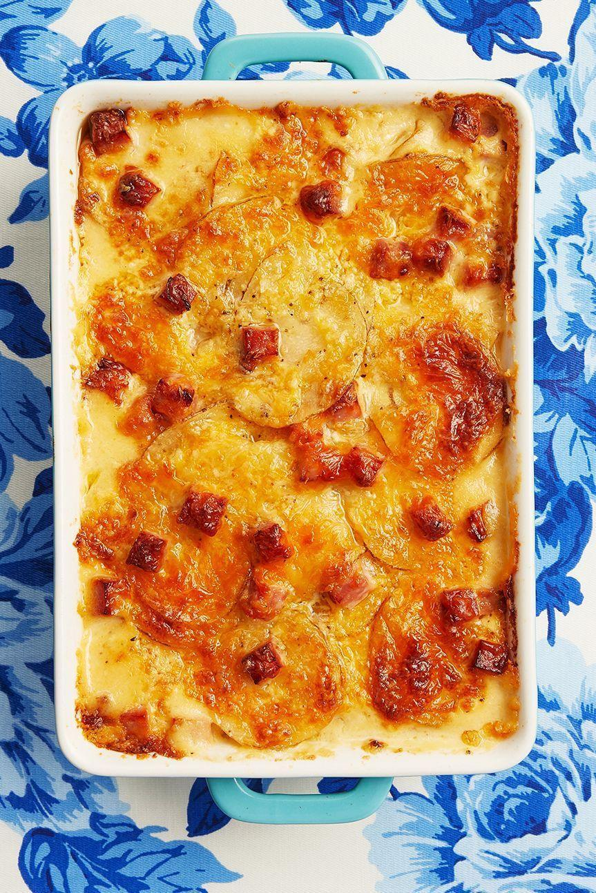 "<p>Special occasions call for cheese, cheese, and more cheese. This dish is loaded with all of the above...plus creamy layers of potatoes and flavorful leftover ham. </p><p><strong><a href=""https://www.thepioneerwoman.com/food-cooking/recipes/a10593/scalloped-potatoes-and-ham/"" rel=""nofollow noopener"" target=""_blank"" data-ylk=""slk:Get the recipe"" class=""link rapid-noclick-resp"">Get the recipe</a>.</strong></p><p><a class=""link rapid-noclick-resp"" href=""https://go.redirectingat.com?id=74968X1596630&url=https%3A%2F%2Fwww.walmart.com%2Fsearch%2F%3Fquery%3Dmeasuring%2Bcups&sref=https%3A%2F%2Fwww.thepioneerwoman.com%2Ffood-cooking%2Fmeals-menus%2Fg35589850%2Fmothers-day-dinner-ideas%2F"" rel=""nofollow noopener"" target=""_blank"" data-ylk=""slk:SHOP MEASURING CUPS""><strong>SHOP MEASURING CUPS</strong></a></p>"