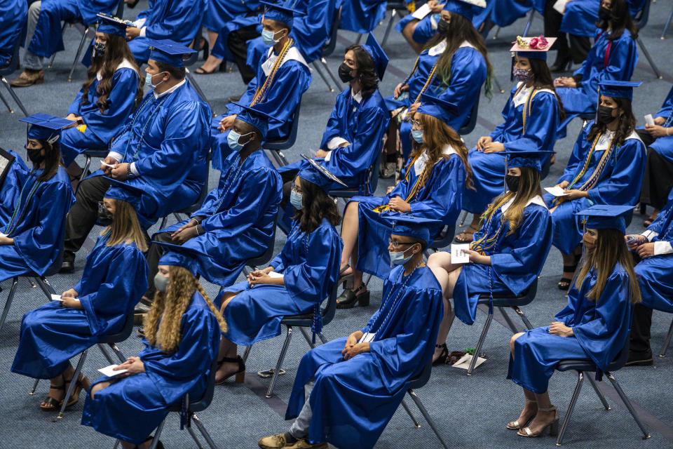 The 2021 graduating class of Odessa Career & Technical Early College High School listens as the salutatorian speaks during their graduation ceremony at Odessa College Sports Center on Friday, May 21, 2021 in Odessa, Texas. (Eli Hartman/Odessa American via AP)